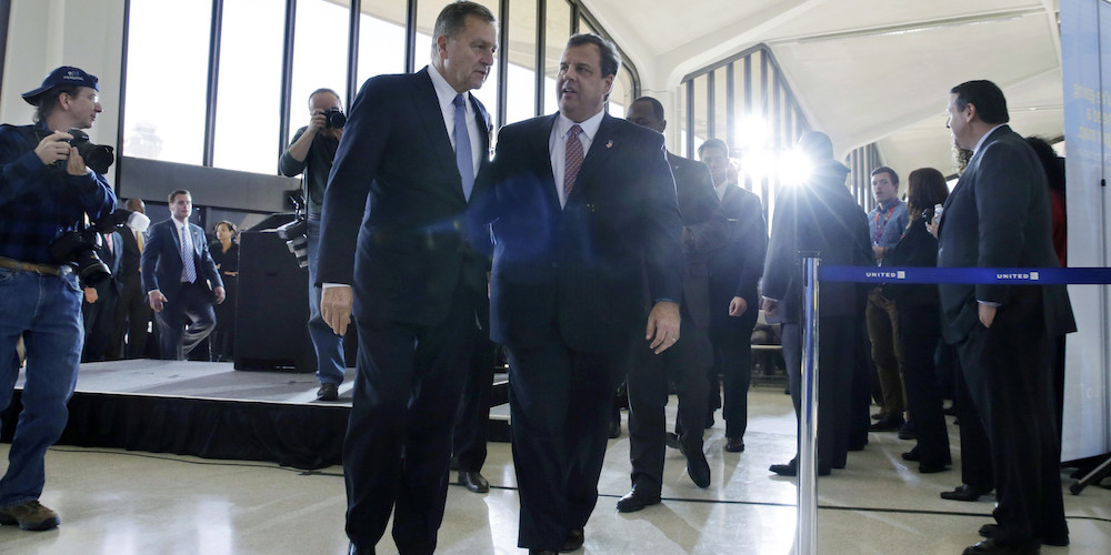 New Jersey Gov. Chris Christie, center, walks with New York/New Jersey Port Authority Chairman David Samson at Newark Liberty International Airport, in Newark, N.J., Thursday, Nov. 14, 2013, after they, Senate President Steve Sweeney and United Airlines CEO Jeff Smisek announced that United Airlines will begin service to Atlantic City International Airport starting in April. (AP Photo/Mel Evans)